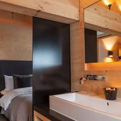 Baños de estilo  por RH-Design Innenausbau, Möbel und Küchenbau Aarau