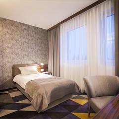 Pokój hotelowy: styl , w kategorii Małe sypialnie zaprojektowany przez Malcherek Studio