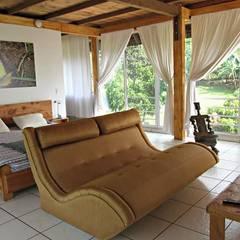 Villa Migelita ecolodge : Habitaciones de estilo  por Brand  Aquitecto interiorista