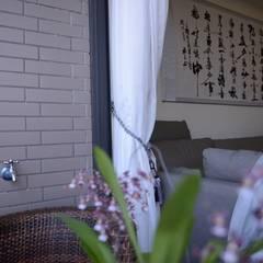 台中新成屋設計 - 帶有東方人文氣息的舒適居所 :  陽台 by 台中室內設計裝修|心之所向設計美學工作室
