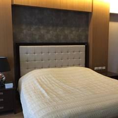 Arya Residences:  Bedroom by Geraldine Oliva