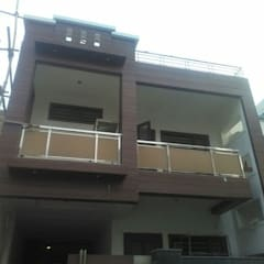 Front Elevation Design - HPL (High Pressure Laminates):  Multi-Family house by 360 Home Interior