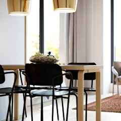 The Loft:  Dining room by Design Concept creative studio