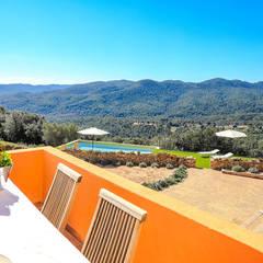 Home Staging en Masía en Girona: Terrazas de estilo  de Markham Stagers