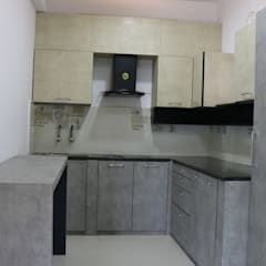 Kitchen units by Enrich Interiors & Decors