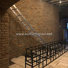 Paredes y pisos mediterráneos de Kültür Tuğlası Mediterráneo Madera Acabado en madera