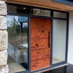 Oxidised metal entrance door:  Front doors by Camel Glass, Modern Iron/Steel