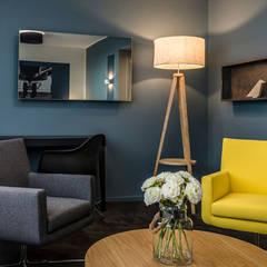 Aménagement intérieur d'un hôtel à proximité d'un aérodrome: Hôtels de style  par Trace & Associes architecture