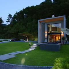 [양평 전원주택] 숲 속의 네 모든 집: 한글주택(주)의  전원 주택