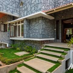 Garden by Archemist Architects, Tropical پتھر