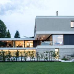Villas de estilo  por PURE Gruppe Architektengesellschaft mbH