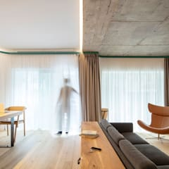 Apartment for a young couple:  Dining room by VATRAA ARCHITECTURE