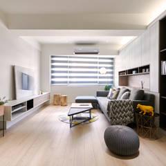 Living room by 耀昀創意設計有限公司/Alfonso Ideas,