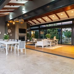 House Milne:  Patios by Hugo Hamity Architects , Modern