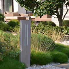 Вилла с садом в стиле модерн. КП Бенелюкс. 2012 г: Tерраса в . Автор – ARCADIA GARDEN Landscape Studio