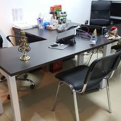 OFICINA NOMINA: Oficinas y tiendas de estilo  por areaxmetro