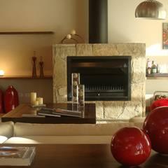 Vivienda Unifamiliar. Fabiana Ordoqui Arquitectura Diseño: Livings de estilo  por Fabiana Ordoqui       Arquitectura y Diseño - Rosario