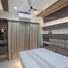 MR.GIRIDHAR GORE'S DUPLEX RESIDENCE AT KHARGHAR:  Small bedroom by DELECON DESIGN COMPANY