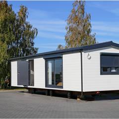 Dom mobilny 12x4m : styl , w kategorii Domy zaprojektowany przez DMK Budownictwo Dariusz Dziuba Sp. K., Mobilne Domki Letniskowe i Całoroczne