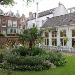 Stedelijke tuin Flora's hof:  Tuin door groenpartners