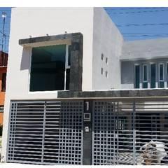 Casas multifamiliares de estilo  por BAUS arquitectos