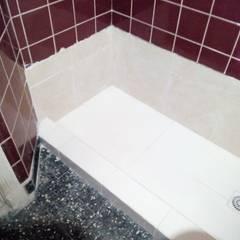 Remodelación baño microcentro Comedores rústicos de Constructora del Este Rústico Cerámico