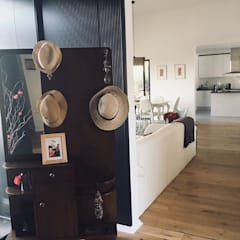 Vivienda Eco en Chamisero: Pasillos y hall de entrada de estilo  por INFINISKI