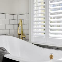 A Stunning Scandi Style Home in Fulham:  Bathroom by Plantation Shutters Ltd