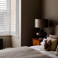 A Classic Contemporary Home in Clapham South:  Small bedroom by Plantation Shutters Ltd