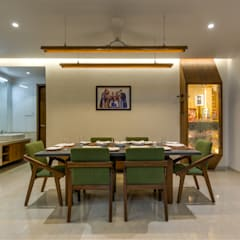 Dining room by Studio Living Stone, Asian