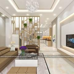 Mẫu nhà đẹp 3 tầng 5x12m đơn giản mà đẹp phù hợp với mọi gia đình:  Phòng khách by Công ty cổ phần tư vấn kiến trúc xây dựng Nam Long