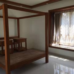 Interiors @Ajmera villows:  Small bedroom by Renovart