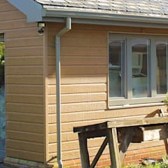 Log cabin by Vulcan Cladding Systems,