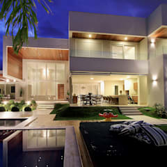 Residência J & F - Delmondes Arquitetura & Interiores: Casas  por Delmondes Arquitetura e Interiores