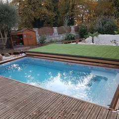Piscinas de jardín de estilo  por AZENCO