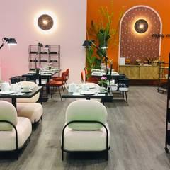Zona de refeições leves: Espaços de restauração  por Margarida Bugarim Interiores