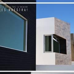 Conjunto Casas LV: Paredes de estilo  por Torres Arquitectos Proyecto y Construcción