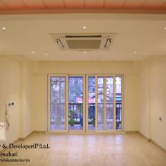 Modern Living Room by Rishika Interior & Developer (p) Ltd. Modern