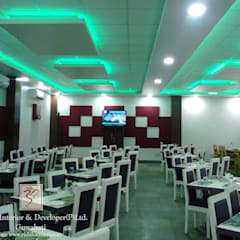 Gastronomy by Rishika Interior & Developer (p) Ltd., Modern