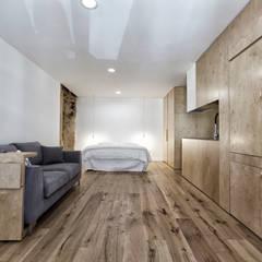 Sant'eramo Flat: Petites chambres de style  par ManGa architects