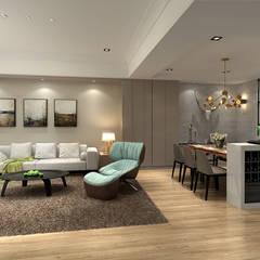Living room by 百玥空間設計