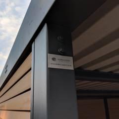 Double powder coated steel frame:  Carport by wearemodern limited