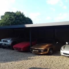 Multi bay carport for a Motor Racing Industry Professional:  Carport by wearemodern limited, Modern Iron/Steel