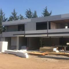 proyecto casa NUA Brisas de Chicureo: Casas unifamiliares de estilo  por Constructora CYB Spa