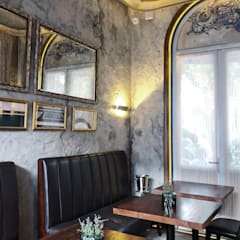 大片的拱型落地窗讓室內光線充足:  室內景觀 by On Designlab.ltd,
