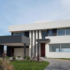 prl80011: Casas unifamiliares de estilo  por CONSTRUCTORA EDIFICAR,Moderno