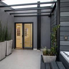 Casa CZM Jardines de invierno minimalistas de Luis Barberis Arquitectos Minimalista