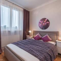 Uwspółcześniona klasyka w centrum Warszawy: styl , w kategorii Sypialnia zaprojektowany przez Koncepcja Wnętrz ,