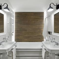Ático Principal: Baños de estilo  de Egue y Seta