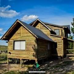 Construcciones de cabañas en tronco: Gastronomía de estilo  por Constructora Belaver,Rústico